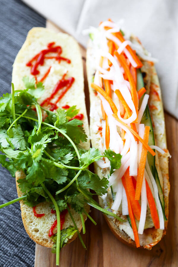 Chicken Banh Mi Sandwich Recipe - Making a Vietnamese Banh Mi Sandwich at home is easier you think! This quick Banh Mi recipe has authentic flavor and only takes 25 minutes to make. Recipe, sandwich, Vietnamese, lunch, chicken sandwich, healthy, dinner | pickledplum.com