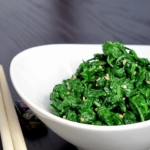 bowl of boiled spinach with sesame seeds