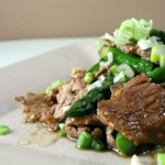 plate of sliced beef and asparagus