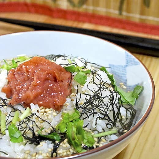 bowl of japanese rice with plum, nori and sesame seeds