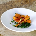 plate of sliced cooked carrots