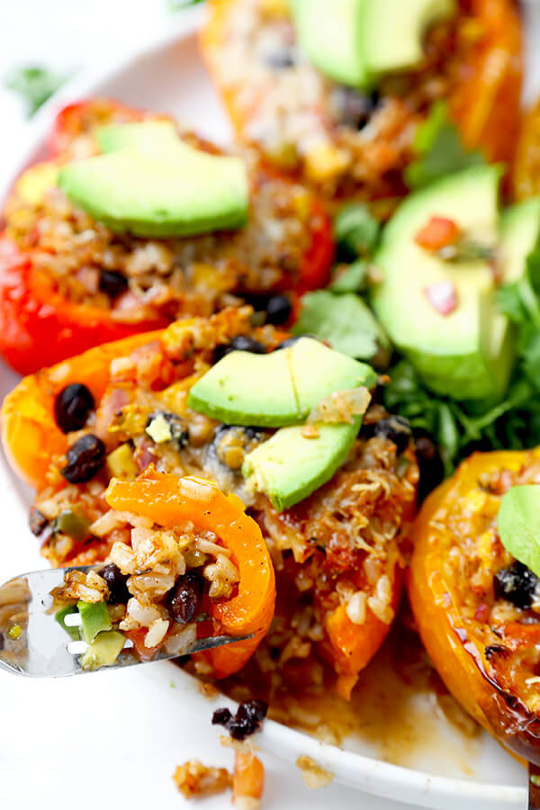 Vegetarian Stuffed Peppers - So colorful and healthy! Serve them as a side or a main and top them with avocado, sour cream and hot sauce. They are filling, delicious and guilt-free! Recipe, vegetarian, vegan, gluten free, healthy | pickledplum.com