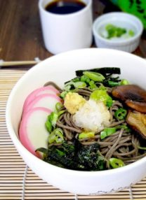 Japanese soba noodles with fish cakes and shiitake mushrooms