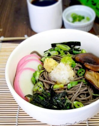 Japanese soba noodles with fish cakes and shiitake mushrooms
