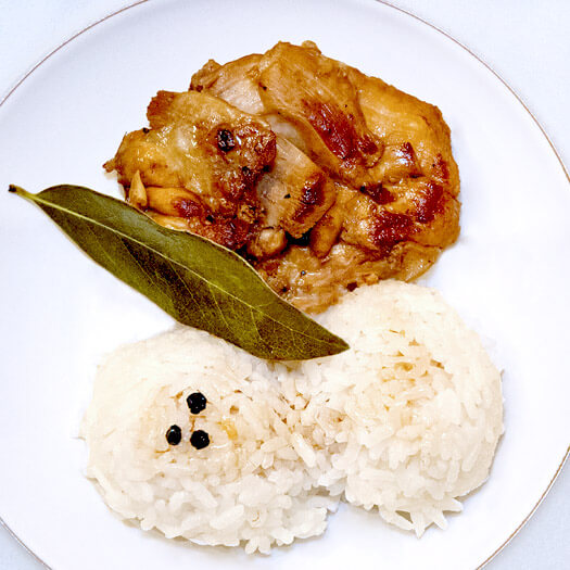 Chicken Adobo Recipe - One of my favorite dishes of all time, chicken adobo is a traditional Filipino dish that's salty, tangy and addictive! Serve it on a bed of rice to soak in all of that adobo goodness! Recipe, chicken, Filipino, dinner, healthy | pickledplum.com