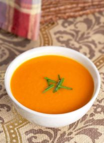 bowl of tomato soup with chives