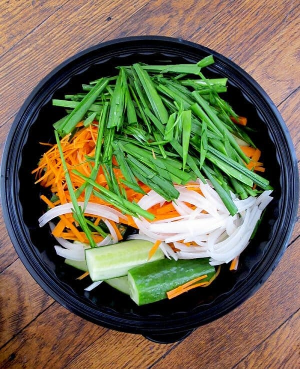Chopped scallions, carrots, onions and cucumber