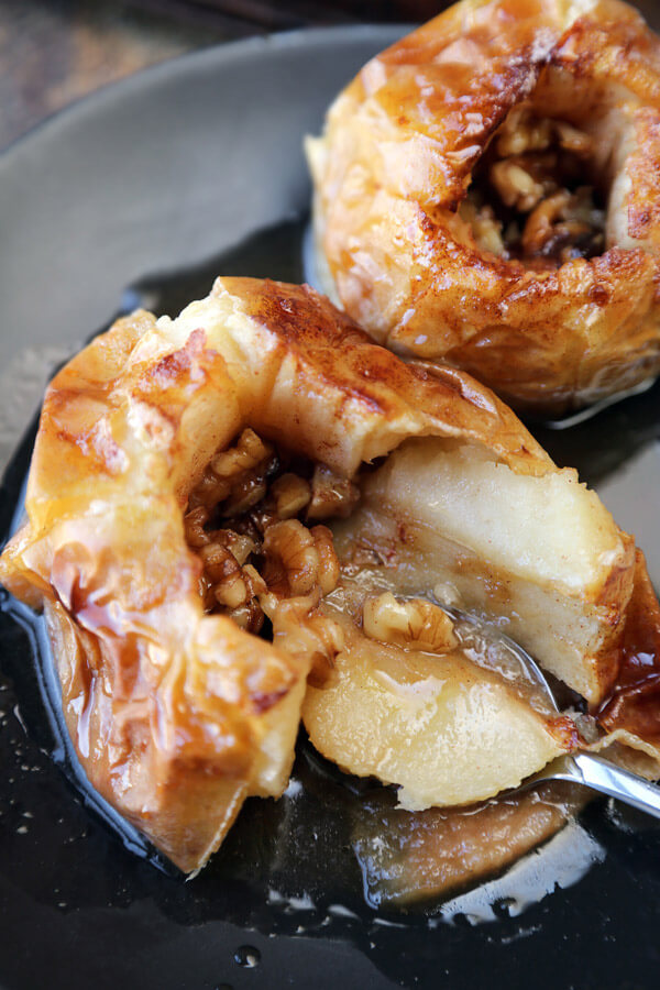 These sweet and tart baked apples with walnuts and cider will change the way you see healthy desserts! And prepping only takes five minutes!