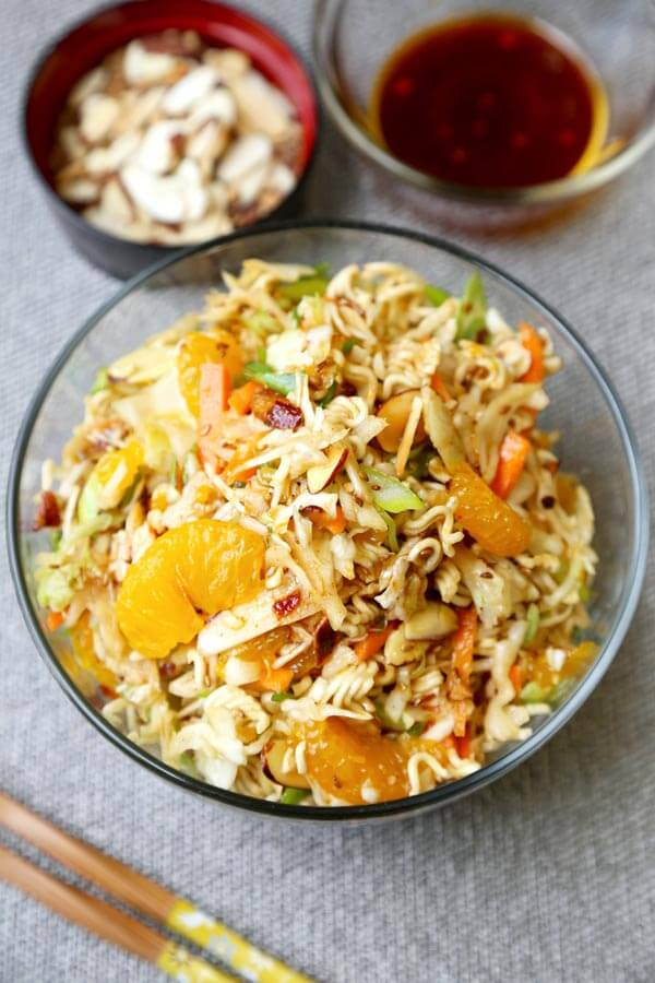 Ramen Noodle Coleslaw - This is an easy ramen noodle salad recipe with cabbage, mandarin oranges, slivered almonds and crunchy ramen noodles, tossed in an oriental dressing that's sweet and tangy. Yummy! #saladrecipe #asiansalad #ramennoodles| pickledplum.com