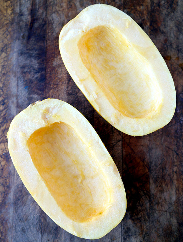 Raw spaghetti squash cut in half.