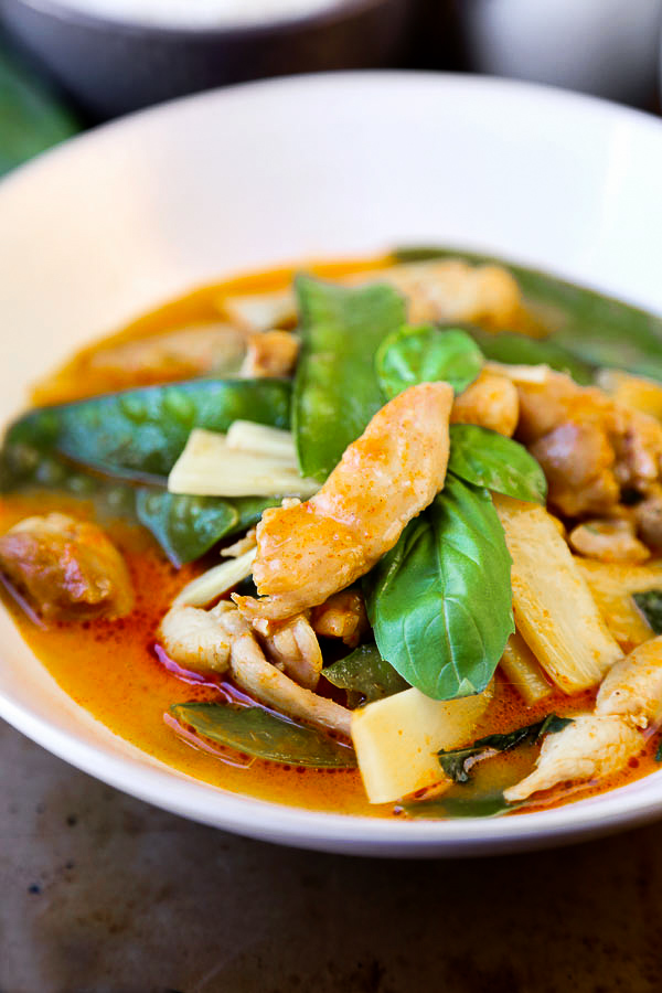 Thai Red Chicken Curry - an authentic thai coconut curry recipe that's easy and healthy! Make it spicy (or not) and add your favorite ingredients. I've added chicken, bamboo and snow peas. Delicious! #thaifood #curryrecipe #asianrecipes #chickenrecipes #currypaste pickledplum.com