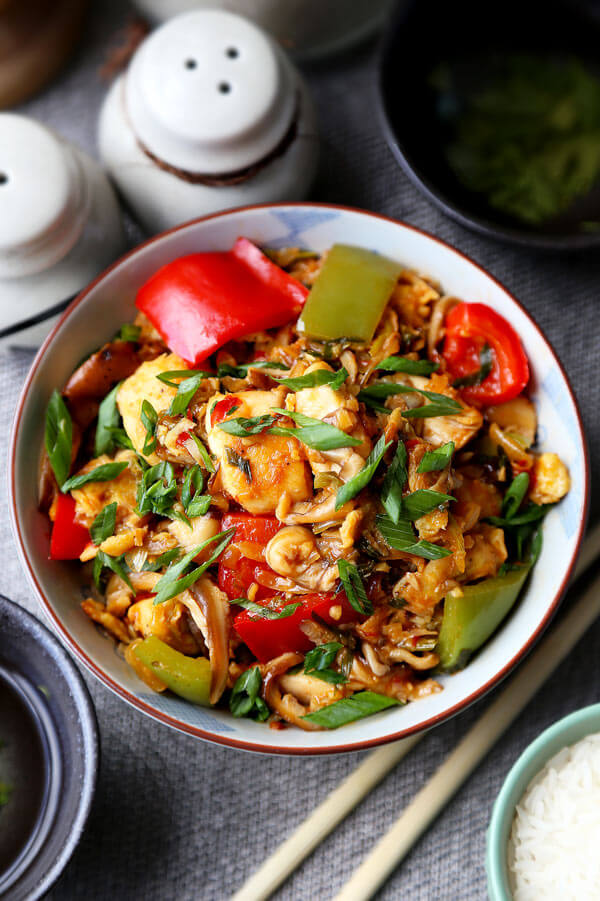 Szechuan Chicken Recipe - This Szechuan chicken stir fry hits the spot whenever I'm craving heat. The silky chicken pieces and vibrant veggies are a healthy combination that's packed with flavor. Chinese food recipes, healthy chicken dinner recipes, easy chicken stir fry, spicy Asian chicken recipe, Chinese stir fry | pickledplum.com