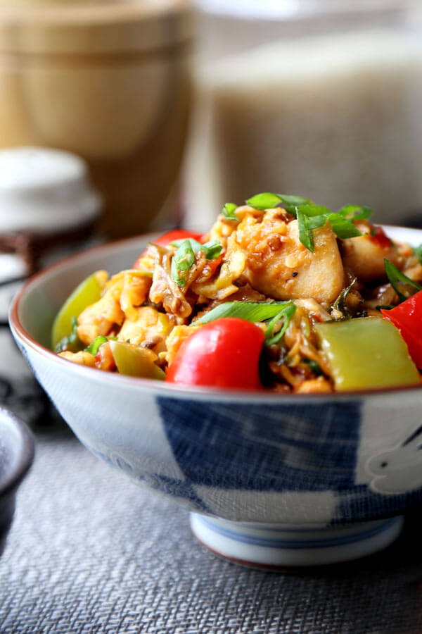 Szechuan Chicken Recipe - This Szechuan chickenstir fry hits the spot whenever I'm craving heat. The silky chicken pieces and vibrant veggies are a healthy combination that's packed with flavor. Chinese food recipes, healthy chicken dinner recipes, easy chicken stir fry, spicy Asian chicken recipe, Chinese stir fry | pickledplum.com