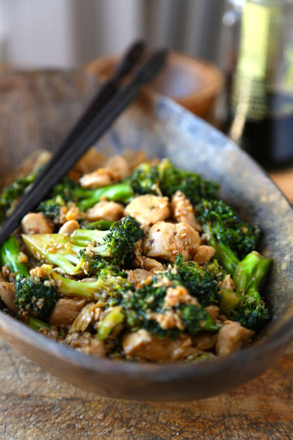 Easy chicken broccoli stir fry cooked in a simple savory sauce and ready in less than 20 minutes! This simple recipe is great if you are busy but still want homemade Chinese! | pickledplum.com