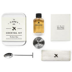 FOR THE TRAVELER The Carry on Cocktail Kit Gin & Tonic with carry on tin, recipe card, bar spoon, 1/2 ounce jigger, tonic syrup and linen coaster. SHOP