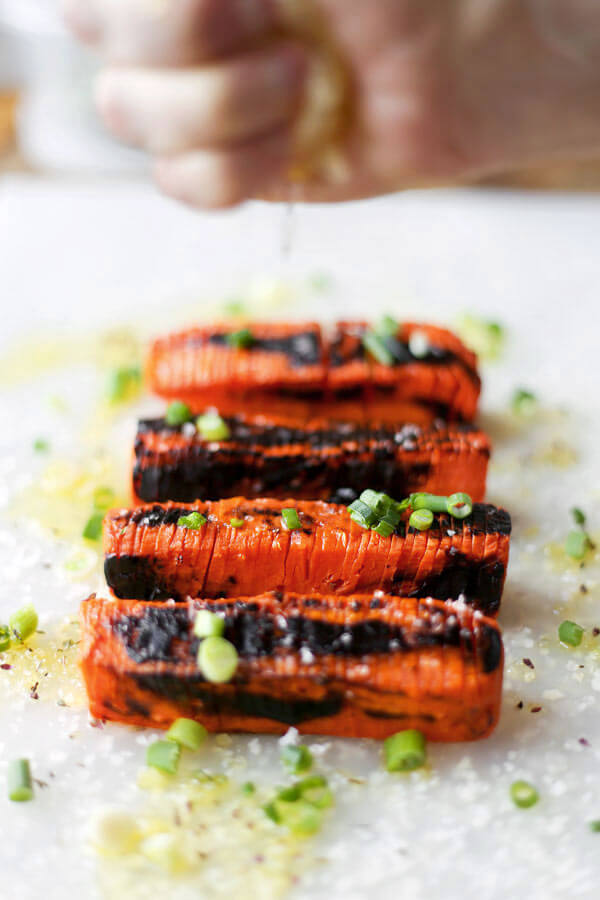 Blackened Hasselback Carrots - These Hasselback carrots only take 20 minutes to make and have the perfect tender/crunchy texture, topped with some sea salt and a fresh squeeze of lemon juice. Scrumptious!Fancy looking carrots you say? These Hasselback carrots are very easy to make, have the perfect tender/crunchy texture and are topped with scallions, sea salt and a fresh squeeze of lemon juice. Scrumptious! Vegan, Gluten free, Healthy Recipe   pickledplum.com
