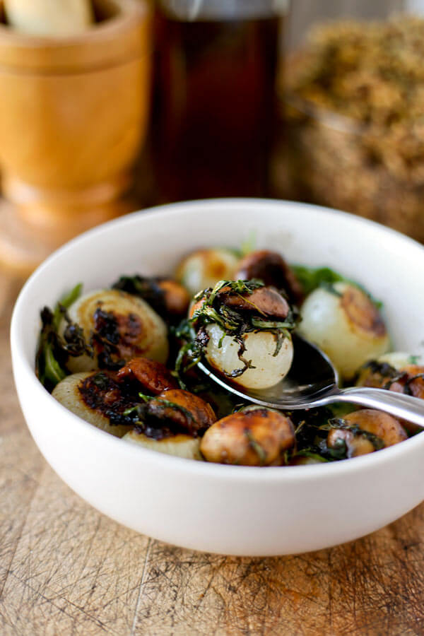 This sauteed mushrooms and onions recipe makes a stunning side dish! Sweet pearl onions and earthy mushrooms are pan fried with butter, paprika and salt and finished in the oven. Ah-mazing! Vegetarian, Easy, Healthy | pickledplum.com
