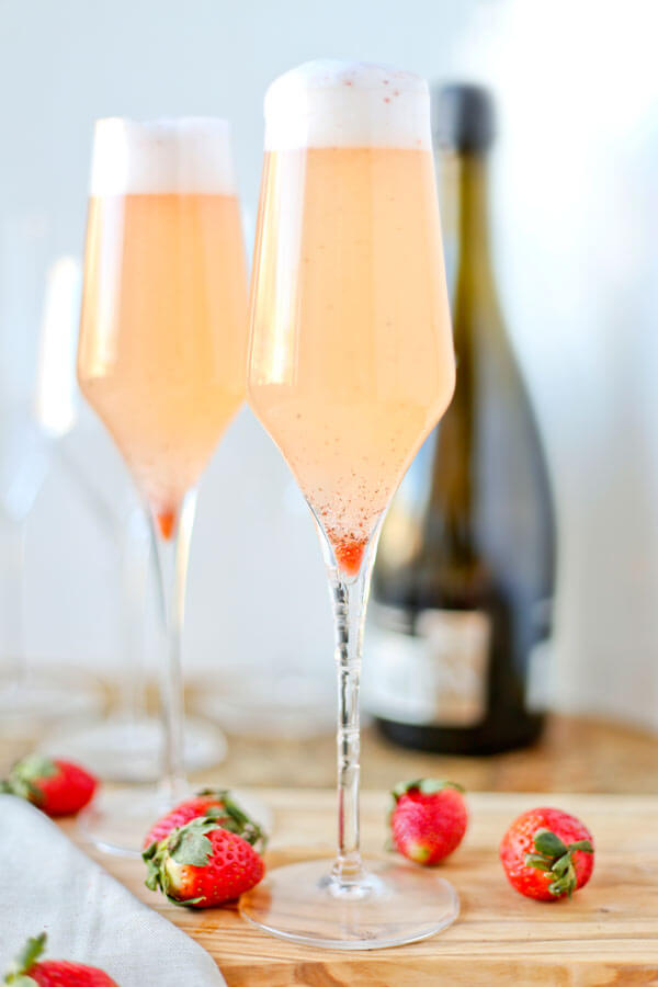 Strawberry-Thyme Prosecco Floats - These strawberry-thyme prosecco floats are such a treat! Sweet and a little tart, and with hints of citrus and herbs, they taste like a refreshing fruity dessert in a glass! | pickledplum.com