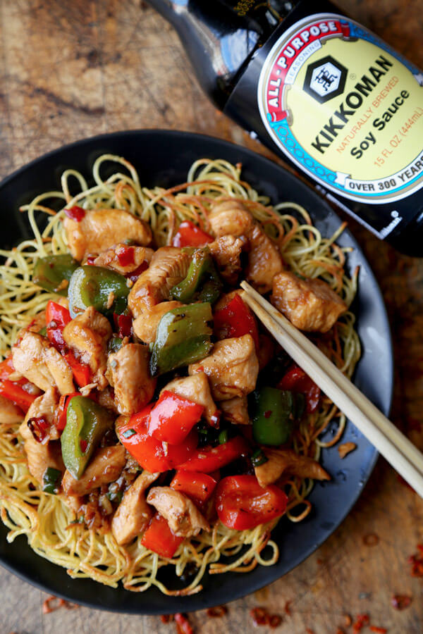 Kung Pao Chicken Recipe - Celebrate Chinese new year with this traditional and delicious kung pao chicken recipe! Served on crispy noodle cakes, it's a fun and colorful meal to enjoy with friends and family! | pickledplum.com