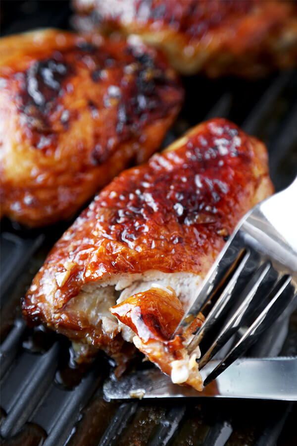 Baked Chicken Thighs with Soy Marinade - Moist and tender baked chicken thighs with a simple soy and honey marinade - less than 10 minutes to prep and simply delicious! Easy, chicken, recipe | pickledplum.com