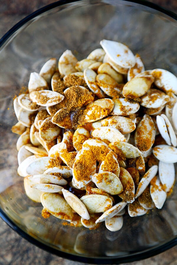 Spiced Roasted Pumpkin Seeds - These spiced roasted pumpkin seeds are sweet, salty and packed with nutrients. Whether it's fall, winter, spring or summer, they are the perfect, healthy mid afternoon snack! Healthy, vegetarian, gluten free | pickledplum.com
