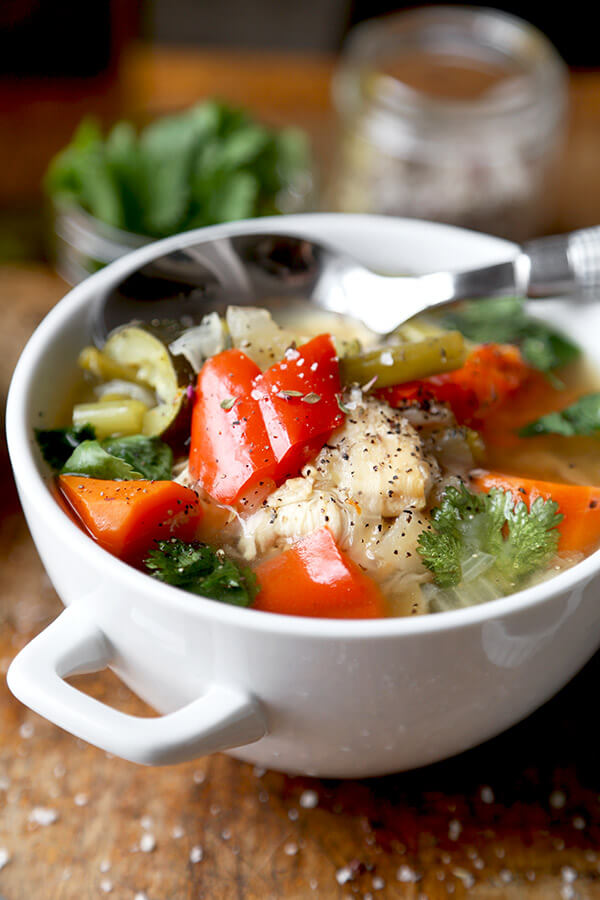slow-cooker-chicken-soup - Slow Cooker Chicken Soup - This simple slow cooker chicken soup is packed with veggies and simmered in a light and delicate chicken stock. It's low in calories and fat and only takes 10 minutes to prep. Gluten free, weight loss. | pickledplum.com