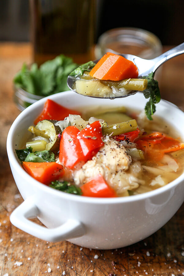 Slow Cooker Chicken Soup - This simple slow cooker chicken soup is packed with veggies and simmered in a light and delicate chicken stock. It's low in calories and fat and only takes 10 minutes to prep. Gluten free, weight loss. | pickledplum.com