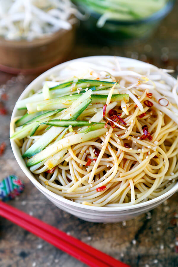 Cold Asian Noodle Salad - This is a quick and easy, spicy and nutty cold Asian noodle salad your whole family will love! Perfect for a barbecue or as a light lunch or dinner + ready in just 15 minutes! Recipe, Easy, Noodles, Healthy, Salad, Vegetarian, Vegan | pickledplum.com