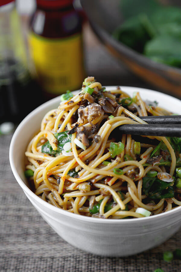 Vegan Dan Dan Noodles - This is a vegan recipe for dan dan noodles you won't be able to stop eating! Chopped mushrooms replace the ground meat and bring earthiness to this spicy, nutty and tangy noodle dish. Yummy! Chinese, Noodles, Easy, Recipe, Vegan | pickledplum.com