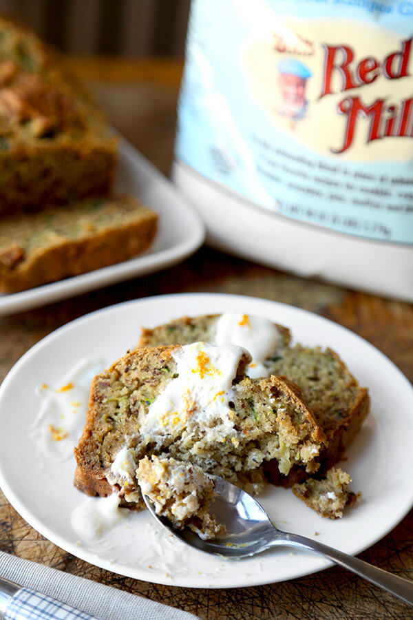 Gluten free zucchini bread - Serve this yummy gluten free zucchini bread as part of your Easter Sunday brunch this year! Topped with a honey orange yogurt sauce, it's the perfect balance of sweet and sour! Easy, gluten free, baking, recipe | pickledplum.com