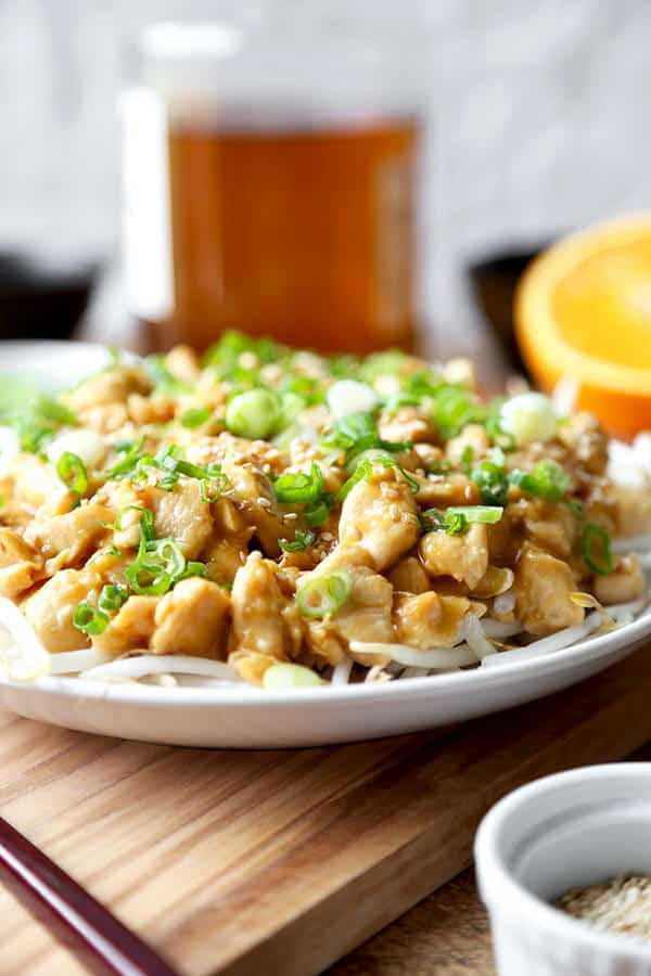 Orange Chicken Recipe - This easy to make and naturally sweet Orange Chicken Recipe is a delicious take on the American-Chinese classic and is ready in 20 minutes. A fun and tasty meal for the entire family! Recipe, chicken, stir fry, Chinese food, better than takeout | pickledplum.com