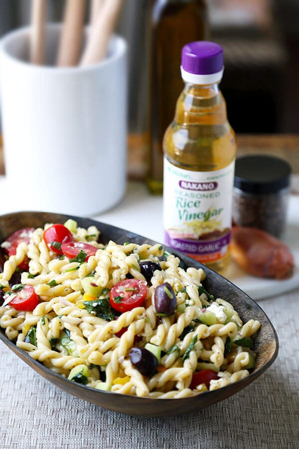 Greek Pasta Salad - This is a light, refreshing and tangy Greek pasta salad recipe packed with veggies for a wholesome meal! Ready in 25 minutes from start to finish. Recipe, salad, side, main, healthy, easy | pickledplum.com