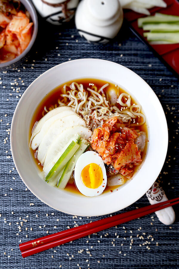 Shirataki Cold Noodle Soup - Healthy, refreshing and good for your bikini body! This ice cold shirataki noodle soup topped with sweet pear and spicy kimchi is only 222 calories per servings and filling enough to be eaten as a meal! Recipe, soup, low calories, diet, weight loss, noodles, healthy, noodle soup | pickledplum.com