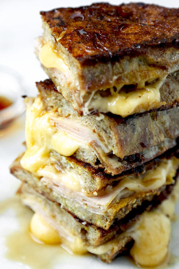 Monte Cristo Sandwich - This Monte Cristo Sandwich Recipe delivers on the gooey, savory perfection of grilled cheese and the sweetness of French Toast. Ready in 10 minutes from start to finish! Recipe, sandwich, grilled cheese, snack, brunch, breakfast, easy | pickledplum.com