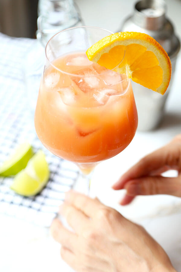 This Sex On The Beach cocktail just oozes fruity summer refreshment. Colored like a beautiful sunset, this is the perfect fruity mixed drink for a late-summer party! #howtomake #drinks #parties #fruitcocktail #alcoholicdrink #girlydrink | pickledplum.com