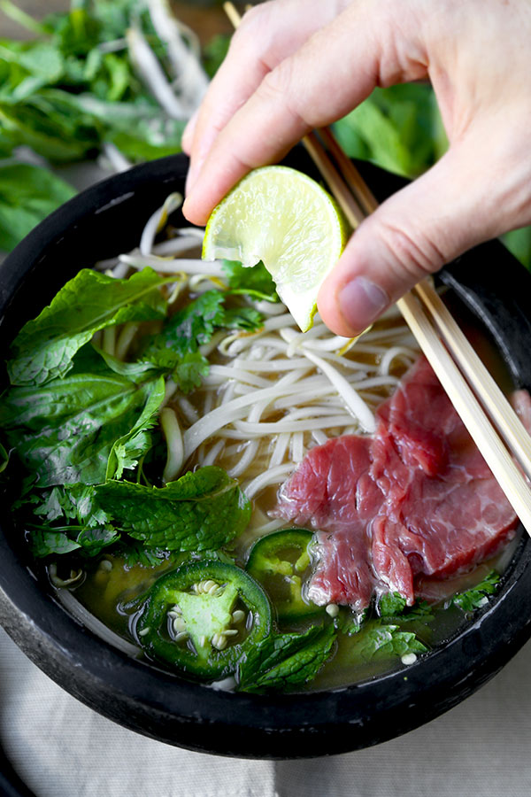 Easy Pho Soup - Slurp your noodles with abandon in 30 minutes with this Easy Pho Soup Recipe! A quick, satisfying and full-flavor version of Vietnam's national dish. Recipe, soup, Vietnamese food, noodle soup, healthy, pho soup | pickledplum.com
