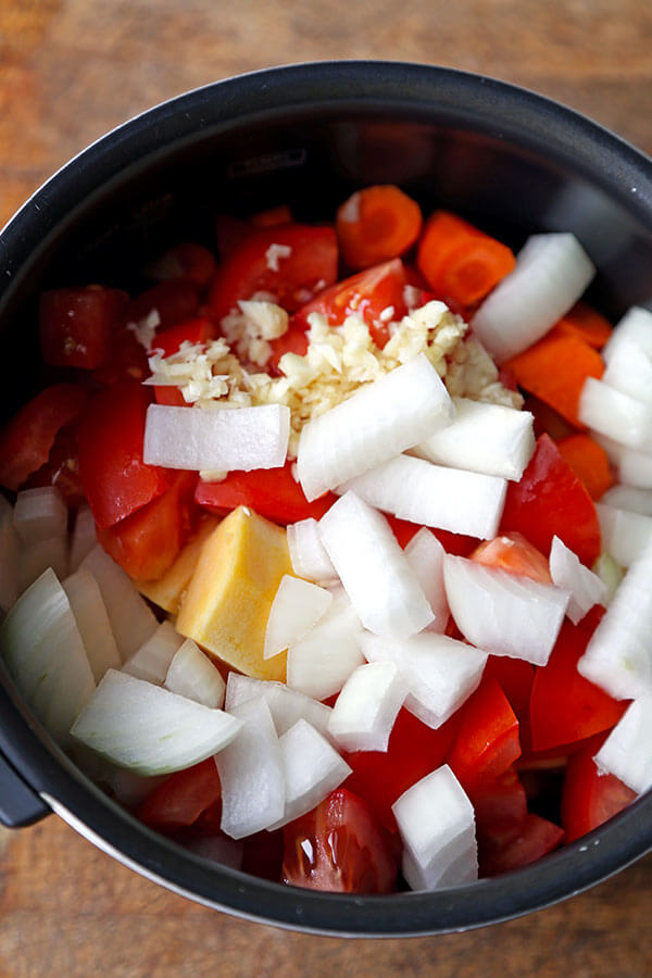 Slow Cooker Autumn Vegetable Soup - This is a healthy vegetarian recipe for the best slow cooker vegetable soup. Low carb, vegan and gluten free, this soup is packed with veggies and beans and tastes both sweet (from tomatoes) and savory. Ideal for weight loss, diets and weight watchers whole 30! #whole30 #vegansoup #veganrecipes # healthyeating | pickledplum.com