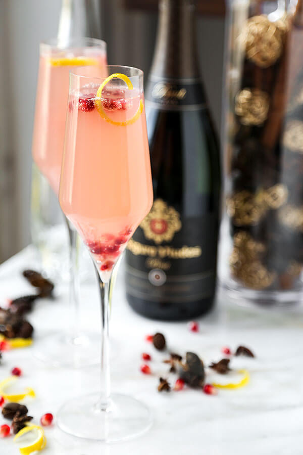 Spiked Pomegranata Cava - A pomegranate spiked Cava with plenty of zing! Grated ginger and lemon juice make this holiday cocktail a light and refreshing alternative. Recipe, drinks, Champagne, cocktail, New Year's, holiday | pickledplum.com