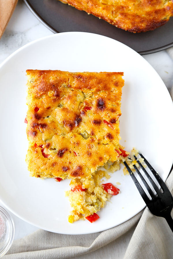 Lightened Up Corn Casserole - This Lightened Up Corn Casserole Recipe has the spirit of cornbread with the soul of a creamy autumn casserole. Ready in 40 minutes from start to finish! Recipe, Thanksgiving, Christmas, corn, side dish, baking | pickledplum.com