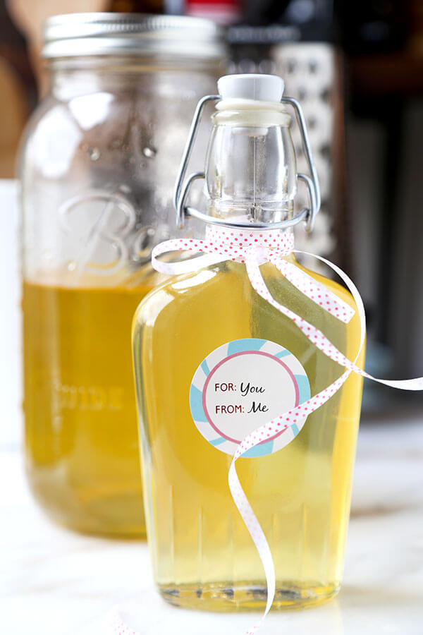 Limoncello - Make your own Limoncello this holiday season with just 3 ingredients! Serve it with soda and a splash of cranberry juice or bottle it up for the cutest and cheeriest homemade gift! Recipe, how to make limoncello, diy, alcohol, cocktail, vodka, drink | pickledplum.com