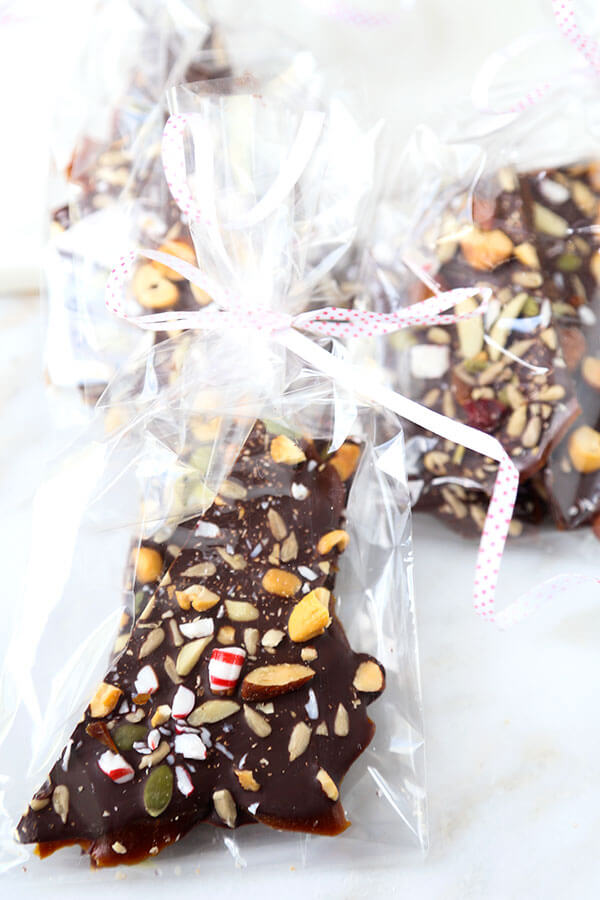 Super Nutty Chocolate Peppermint Bark - One layer of naughty and two layers of nice make this Super Nutty Chocolate Bark the perfect sweet, holiday inspired treat. It also makes a great homemade gift! Recipe, Thanksgiving, Christmas, toffee, dessert, snack, chocolate   pickledplum.com