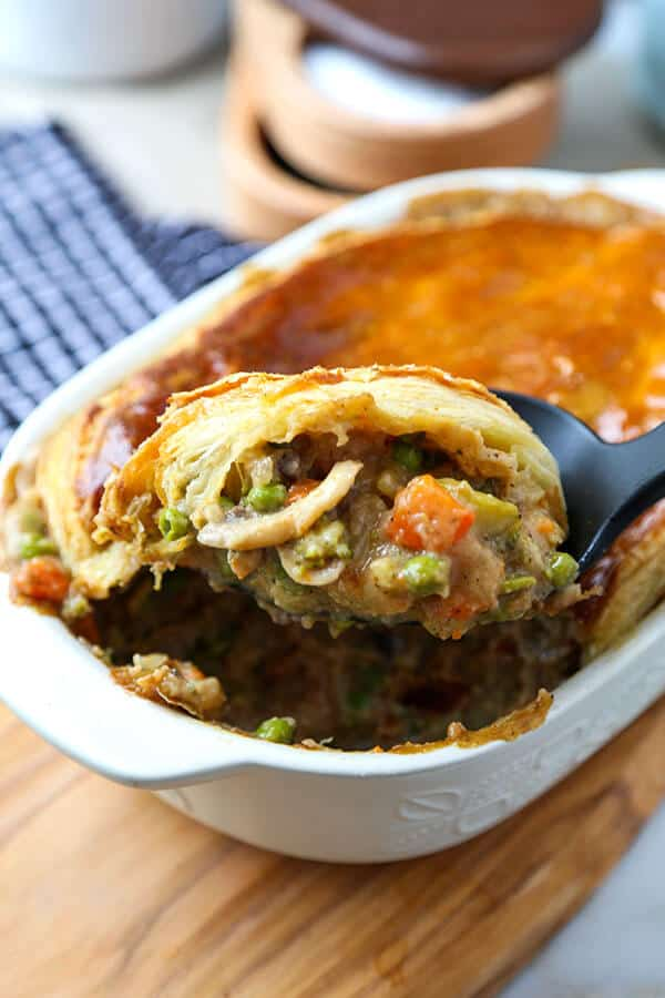 Hearty Vegetable Pot Pie - This hearty vegetable pot pie with creamy mushroom sauce and topped with puff pastry is guaranteed to keep you warm this winter! Recipe, dinner, vegetables, baking, pie | pickledplum.com