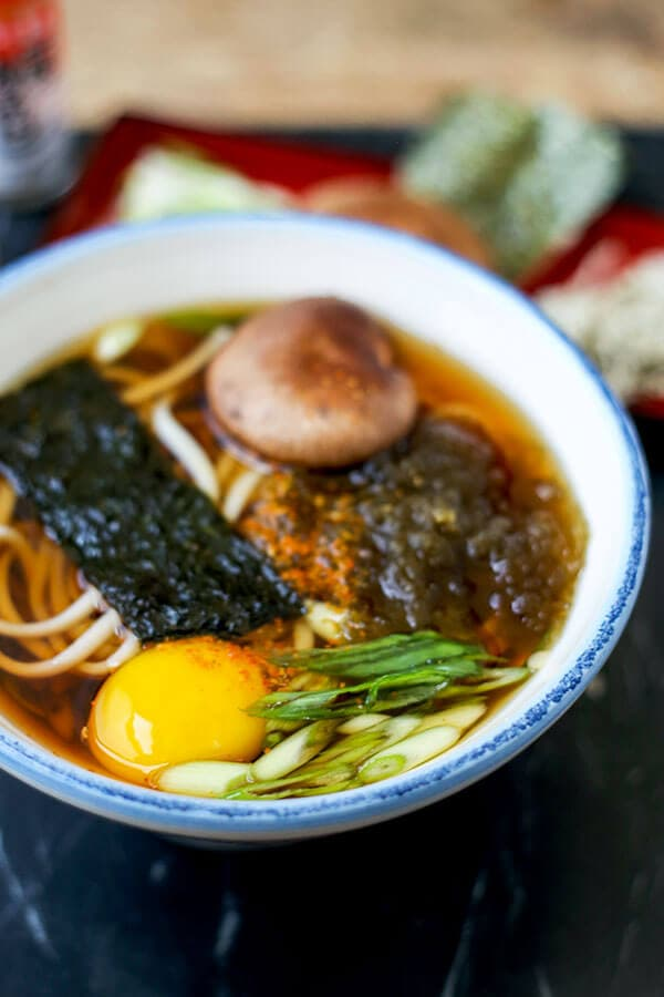 Light Udon Noodle Soup Recipe - This Light Udon Noodle Soup Recipe is the comfort food to eat this winter! Enjoy a bowl of chewy udon noodles in a light, savory broth in just 15 minutes from start to finish. Recipe, Japanese, noodles, udon, soup, healthy | pickledplum.com
