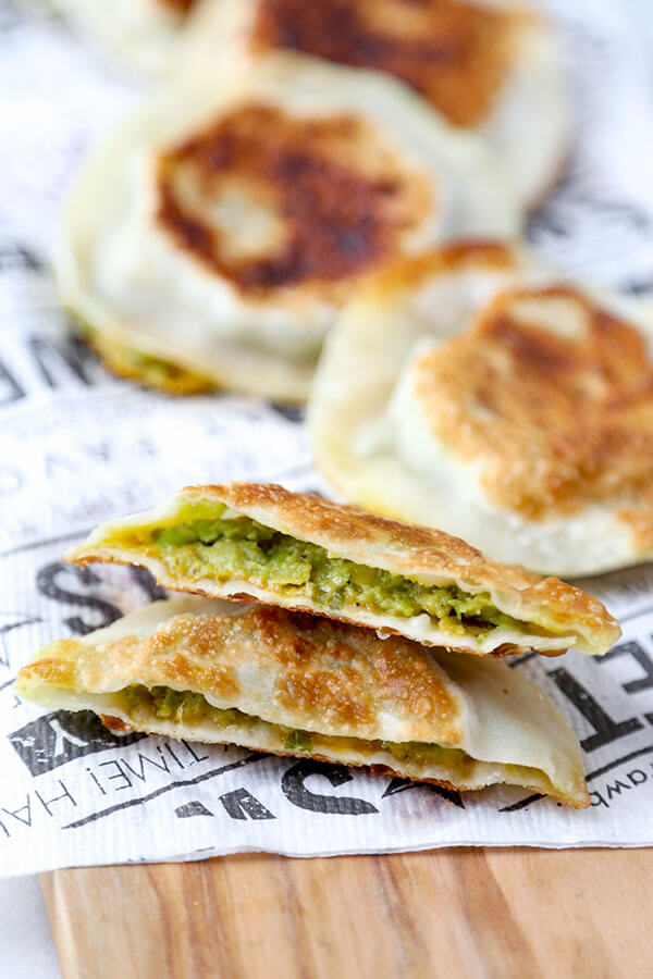 Avocado & Cheese Dumplings - Easy, crispy, creamy, pillowy avocado and cheese dumplings that are so delicious, you won't be able to stop at just one! Ready in 10 minutes, gone in less! Recipe, snack, dumpling, gyoza, avocado, appetizer | pickledplum.com
