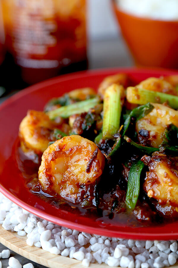 Garlic Shrimp With Chili Crisp - This garlic shrimp recipe is nothing like you've ever tasted before! We've the taken the classic recipe and turned it upside down to bring garlic shrimps that are smoky, salty, nutty and with just enough heat to make you reach for a spoonful of rice. It's insanely delicious! Recipe, shrimp, stir fry, Chinese food, easy recipe | pickledplum.com