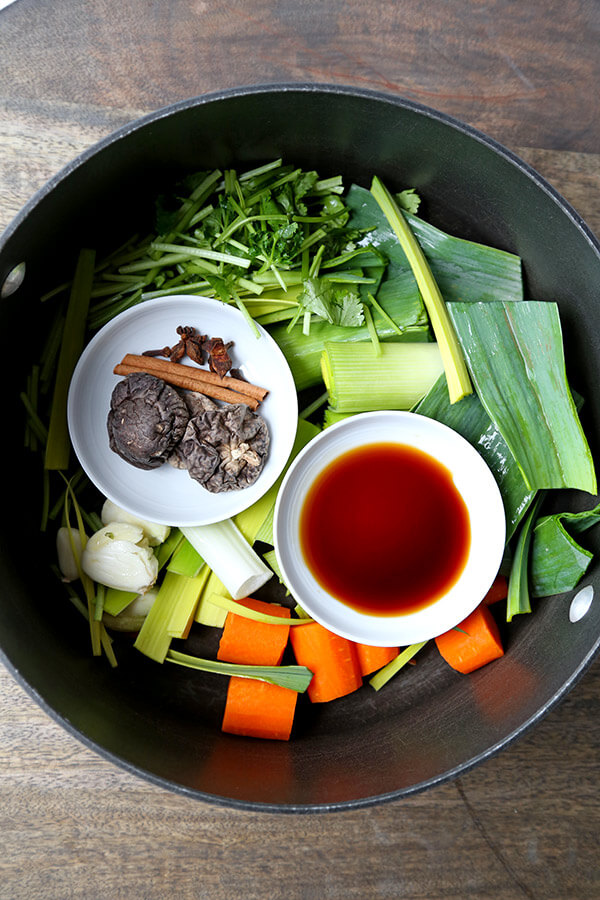 Vegetable Pho Broth - This is a mild yet fragrant vegetable pho broth recipe. Who says you need meat to make everything better? This vegan pho broth proves that veggies done well can taste spectacular! Recipe, vegan, vegetables, soup, pho, stock   pickledplum.com