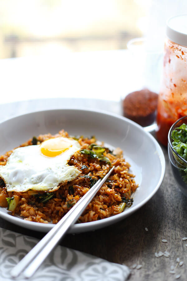 Kimchi Fried Rice - Whip up this quick and easy kimchi fried rice in less than 15 minutes! The addition of kale adds an extra boost of nutrients to this already healthy and scrumptious recipe! stir fry, recipe, Korean food, fried rice, kimchi, meatless | pickeldplum.com