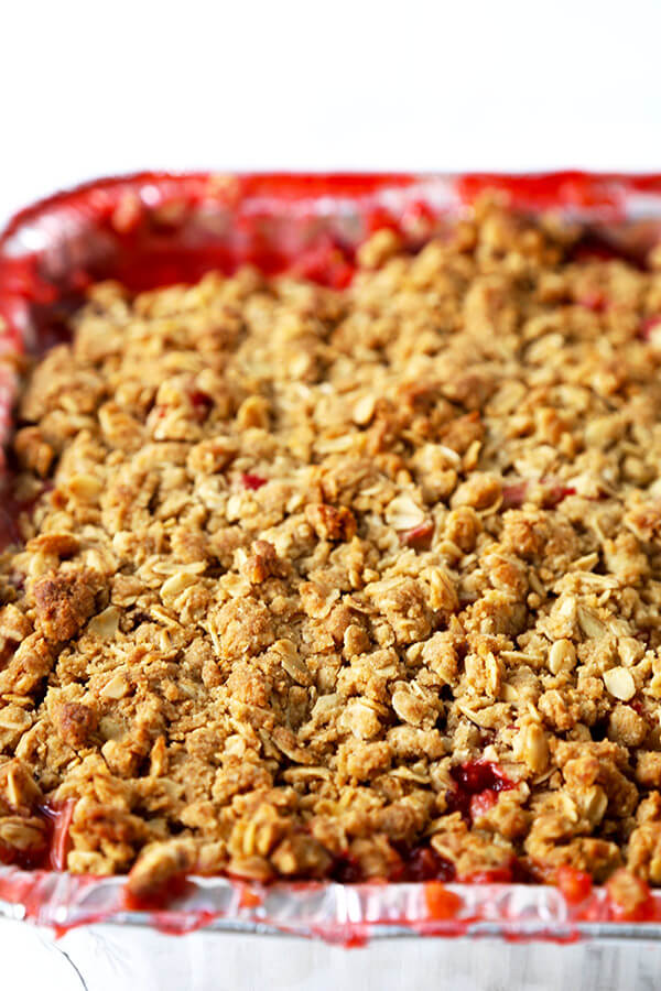 Strawberry Rhubarb Crisp - A strawberry and rhubarb crisp that's both sweet and tart and topped with a generous layer of crispy crumble. It's the perfect spring and summer dessert that pairs well with a scoop of vanilla ice cream! Recipe, dessert, fruit, healthy, crumble | pickledplum.com