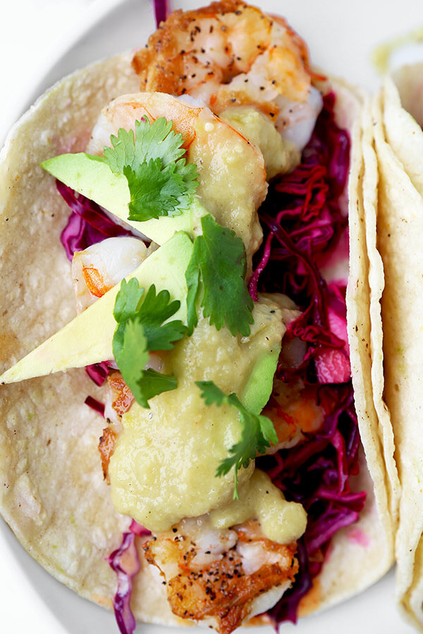 Shrimp Tacos with Tomatillo Sauce - Who knew it was this easy to make unforgettable shrimp tacos topped with colorful, refreshing and tasty toppings! Not only are these tacos healthy, they are addictive! Recipe, Mexican, tacos, seafood, healthy | pickledplum.com