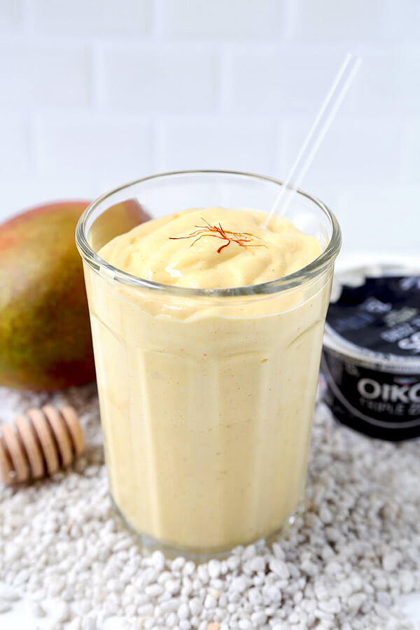 Mango Lassi - Drink it for breakfast, as a mid afternoon snack or serve it for dessert! This 5-ingredients only Mango Lassi recipe is sweet, nutritious and beyond refreshing on a hot summer day! Indian recipe, healthy smoothie recipe, yogurt drink, fruit shake | @oikos, @dannon | pickledplum.com